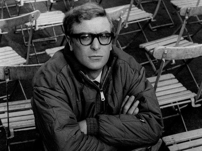 pcress-file-1965-michael-caine-portrait-amid-chairs-00n-ztk-1000x750